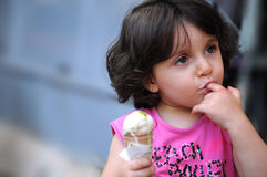 A girl eating ice cream Royalty Free Stock Images