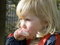 Girl eating ice cream. Young blond girl is enjoying ice cream Royalty Free Stock Photography