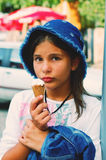 Girl eating ice cream. Girl  with a hat eating ice cream Stock Photography