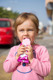 Girl eating an ice cream Stock Photos