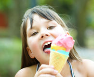 Girl is eating ice-cream Stock Photo