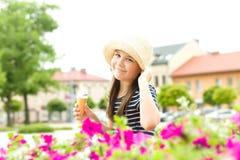 Girl is eating ice-cream Stock Image