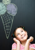 Girl is eating ice-cream Royalty Free Stock Images