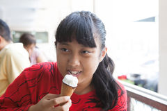 Girl eating ice cream Stock Image