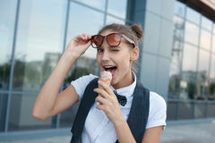 Girl eating ice cream stock photos
