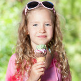 Girl eating ice cream Royalty Free Stock Image