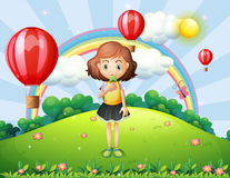 A girl eating an ice cream at the hilltop with hot air balloons. Illustration of a girl eating an ice cream at the hilltop with hot air balloons Royalty Free Stock Photos