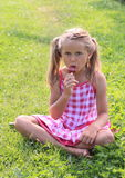 Girl eating ice-cream Royalty Free Stock Images