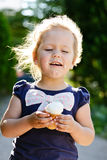 Girl eating an ice-cream Stock Images