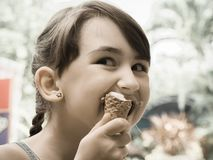 Girl eating ice cream Royalty Free Stock Photography
