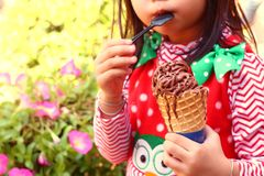 Girl eating ice cream stand. Royalty Free Stock Photography