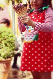 Girl eating ice cream stand. Royalty Free Stock Photo