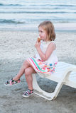 Girl eating ice cream on sunbed Stock Photos