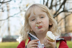 Girl eating ice cream on the walk Royalty Free Stock Image