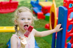 Girl eating ice lolly Royalty Free Stock Photography