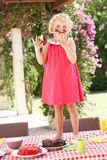 Girl Eating Jelly And Cake At Outdoor Tea Party Stock Photos