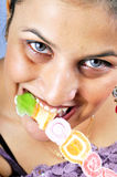 Girl eating jelly candy Stock Photo
