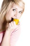 Girl eating lemon Royalty Free Stock Photo