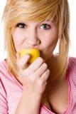 Girl eating lemon Stock Image