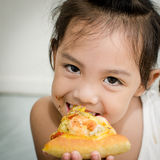Girl eating. Stock Photo