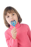 Girl eating lollipop Stock Image