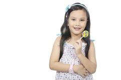 Girl Eating Lollipop Royalty Free Stock Photos