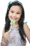 Girl Eating Lollipop Stock Images