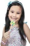 Girl Eating Lollipop Stock Images
