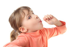 Girl eating lollipop, half body. Girl in red shirt eating lollipop, half body, looking at camera, isolated on white royalty free stock images