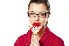 Girl eating lollypop Royalty Free Stock Image
