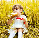 Girl eating a long loaf Royalty Free Stock Photography