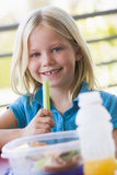 Girl eating lunch at kindergarten Stock Photo