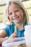 Girl eating lunch at kindergarten Stock Photography