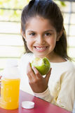 Girl eating lunch at kindergarten.  royalty free stock photography
