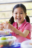 Girl eating lunch at kindergarten Royalty Free Stock Photos