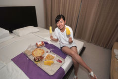 Girl eating a meal in hotel Royalty Free Stock Photos