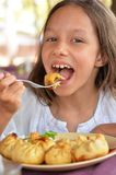 Girl eating meat pockets Royalty Free Stock Photos