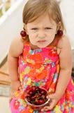 Girl eating merry Stock Photo