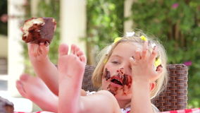 Girl Eating Messy Slice Of Chocolate Cake stock video