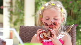 Girl Eating Messy Slice Of Chocolate Cake stock footage