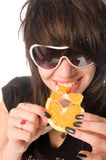 Girl eating orange Stock Image