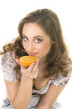 girl eating an orange Royalty Free Stock Image