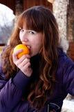 Girl eating orange Royalty Free Stock Photo