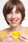 Girl Eating Orange Slice Royalty Free Stock Photos