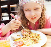 Girl eating pasta Royalty Free Stock Photography