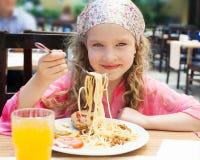 Girl eating pasta Royalty Free Stock Image