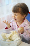 Girl eating pastry Stock Photo