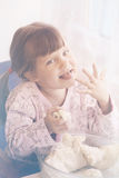 Girl eating pastry Stock Images