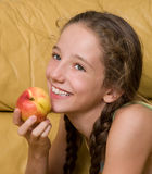 Girl eating peach Royalty Free Stock Photos