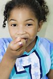 Girl eating a pice of cake/food Stock Image